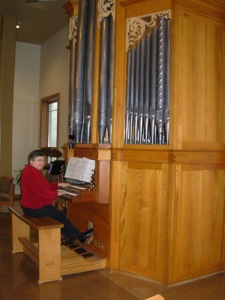 Marian playing the tracker pipe organ at Messiah Lutheran Church in Madison.