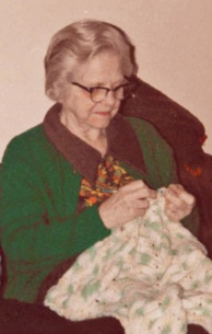 Mom crocheting a baby afghan.