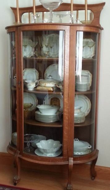 Mom's china cabinet. It's in our dining room now, filled with Mom's china instead of all the other treasures it used to house.