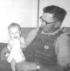 Sitting with his granddaughter, Cindy.