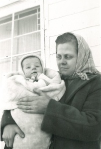 My big brother as a baby being held my Mom