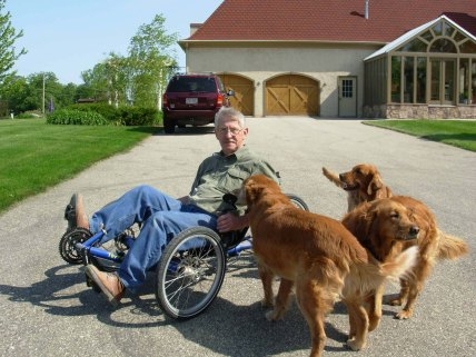 All the dogs get excited when Danny takes his recumbent bike out for a ride.