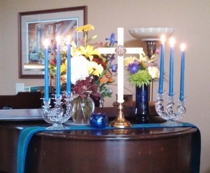 We recreated the altar on our piano at home. Something old: The candelabra were used in her parents' wedding.  Something new: The flowers. Something borrowed: The cross was borrowed from our church. Something blue: The votive candle.