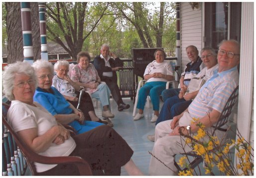 "The Friendship Club visiting with us on our front porch during one of their annual day trips to Wisconsin for ""Lunch with Mim and Marian."""