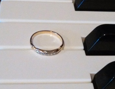 My mom's wedding ring is a simple gold band with seven tiny diamond chips set in the top quarter of the band.