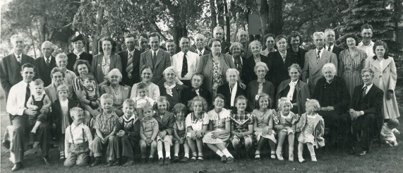 Lots of my relatives - the year before I was born. My brother Danny is sitting on the grass on the right side of the picture - in front of Mom and beside Grandpa.