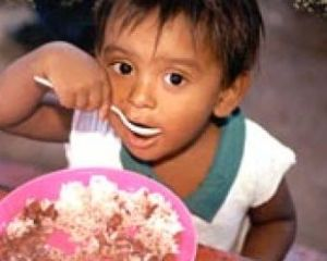 World Vision - girl eating