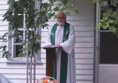 The Rev. John Hagen, a former pastor of Gol, preached briefly from the steps of the farmhouse where the congregation met before the church was built.