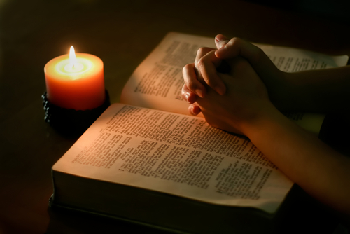 Bible-candle-praying hands