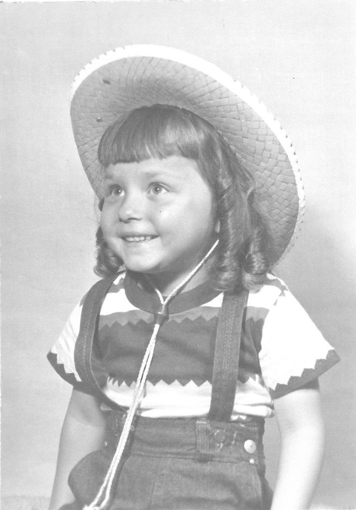 Marian w curls and cowboy hat