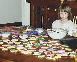 Emily w decorated Xmas cookies