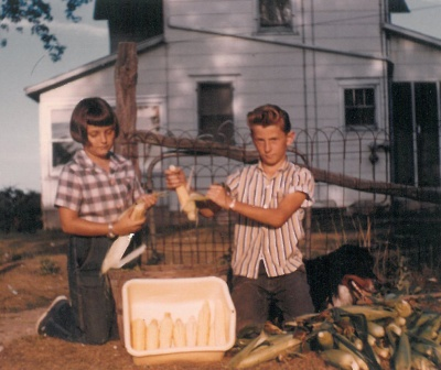 Danny and I had to work together a lot. Here we are spending most of a summer day husking sweet corn for Mom to freeze.