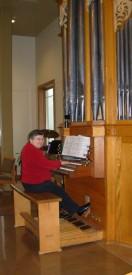 Marian at organ - tall pic